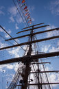 Tall ship ropes and signal flags with on blue sky Stock Image