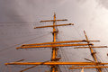 Tall ship at sundown mast colored gold on Stock Images