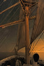 A tall ship under the stars sailing at night Stock Images