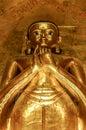 Tall standing golden Buddha showing Dharmachakra Mudra, Gesture Royalty Free Stock Photo