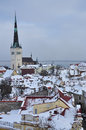 Tallinn medieval old town under snow estonia of winter scene on red roofs Stock Photos