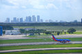 Tampa skyline with plane at Tampa Int'l Airport Royalty Free Stock Photography