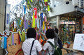 Tanabata or star festival is a japanese festival people writing wishes small pieces of paper and hanging them on bamboo in by on Stock Images