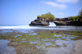 Tanah lot beach at bali indonesia is a rock formation off the indonesian island of it is home to the pilgrimage temple pura a Royalty Free Stock Images