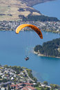 Tandem paragliding over Lake Wakatipu in Queenstown, New Zealand Royalty Free Stock Photo