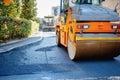 Tandem vibration roller compactor working on asphalt pavement industrial Stock Image