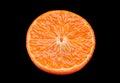 Tangerine fruit slice isolated on black background Royalty Free Stock Photography