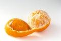 Tangerine half peeled on white Royalty Free Stock Photo