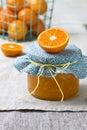 Tangerine jam jar with on a linen napkin Stock Photos