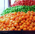 Tangerine oranges lemon and tomatoes Stock Images