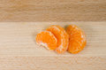 Tangerine segments on a wooden table Stock Photography