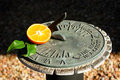 Tangerine with sundial Royalty Free Stock Images