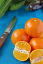 Tangerines on a blue tablecloth ripe juicy Stock Photography