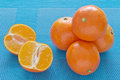 Tangerines on a blue tablecloth ripe juicy Royalty Free Stock Image