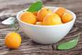 Tangerines in a bowl on old wooden table Royalty Free Stock Photos