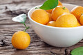 Tangerines in a bowl on old wooden table Royalty Free Stock Image