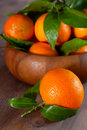 Tangerines in a bowl on wooden background Stock Image