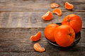 Tangerines on a dark wood background tinting selective focus Stock Photography