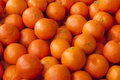 Tangerines fresh and juicy mandarin orange color in bulk Royalty Free Stock Photo