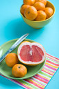Tangerines and grapefruit on plate on table Stock Photography