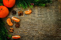 Tangerines and ingredients for baking on a dark wood background tinting selective focus Stock Photos