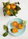 Tangerines with leaves fresh on plate Stock Photo