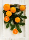 Tangerines on light background in a wooden box Stock Image