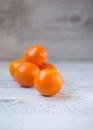 Tangerines ripe orange on white wood focus on front fruit Stock Image