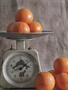 Tangerines on scales Royalty Free Stock Photo