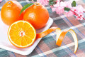 Tangerines on white shaped plate Stock Photography