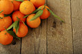 Tangerines on wooden surface top view Stock Image