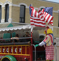 Tangier shrine clown in jalopy in parade in small town america shriner car a summer with flags and ladder Stock Images