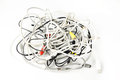 Tangled bunch of various computer cables Royalty Free Stock Photo