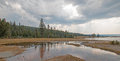 Tangled Creek emptying into Hot Lake hot spring in the Lower Geyser Basin in Yellowstone National Park in Wyoming USA