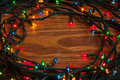 Tangled LED christmas lights on wooden board Royalty Free Stock Photo
