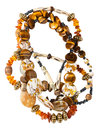 Tangled necklace from amber tigers eye beads natural tiger s bone nacre agate isolated on white background Stock Photos