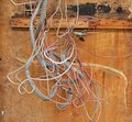 Tangled Wires against wood board