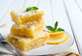 Tangy lemon squares with icing sugar on plate Stock Photo