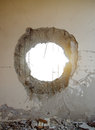 Tank shell impact hole in the wall concrete from with space Royalty Free Stock Photo