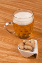 Tankard lager some shelled peanuts Royalty Free Stock Images