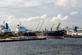 Tankers at urban industrial port massive in an Royalty Free Stock Photo