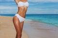 Tanned body in bikini Stock Images
