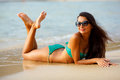 Tanned brunette laying on the beach beautiful tropical Royalty Free Stock Photos