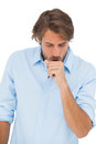 Tanned man coughing on white background Stock Image