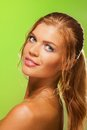 Tanned pretty girl on green Stock Image