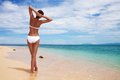 Tanned woman on the beach Royalty Free Stock Photo