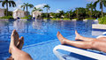 Tanning by the pool two people a resort Stock Photography