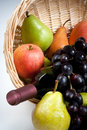 Tantalizing fruit in basket with wine bottle a colorful assortment of delicious begs the viewer to reach for a healthy treat a of Royalty Free Stock Photos
