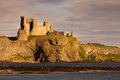 Tantallon castle north berwick scotland is a semi ruined cliff top fortress in east lothian dating to the mid th century and with Royalty Free Stock Image