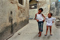 Tanzania zanzibar stone town two dark skinned girls playing i february the island of narrow street small girl years old outdoors Stock Photos